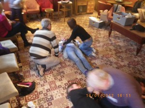 Heather starting to move Sue into the recovery position