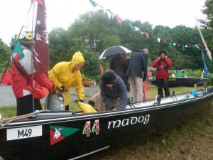 Getting ready to launch in the rain - Maxine (hidden), Leslie, Sue, Bill & Simon