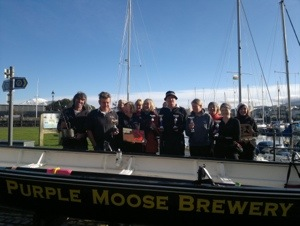 MYC Rowing club members with their haul of trophies from 2012